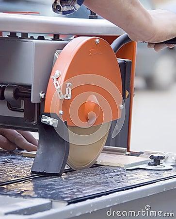 Cutting tiles machine.