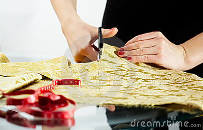Cutting the yellow silk cloth