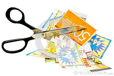 Cuttings of newspaper with scissors