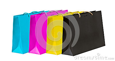 Cyan, magenta, yellow and black shopping bags.
