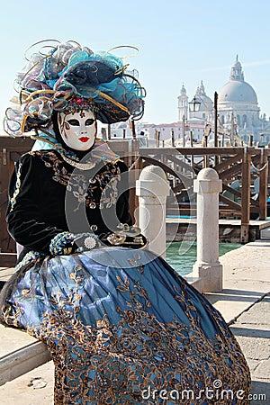 Cyanlady mask with hat at gondola pier