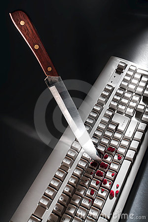 Free Cyber Crime With Knife Stabbing Computer Keyboard Stock Images - 24178814