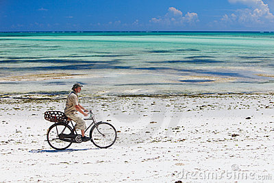 Cycling along tropical beach