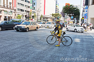 Cycling in the district of Ginza, Japan Editorial Image