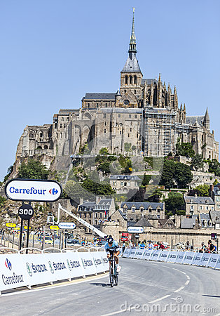 Cycling in Front of Le Mont Saint Michel Editorial Stock Image