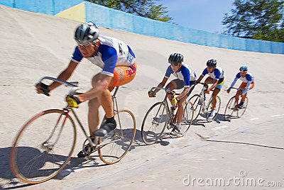 Cycling team fast racing on velodrome Editorial Stock Image