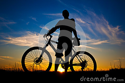 Cyclist with a bike silhouette on a blue sky
