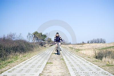 Cyclist on countryside track