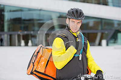Cyclist With Courier Delivery Bag Using Walkie-