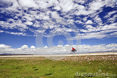 Cyclist cycling under the blue sky