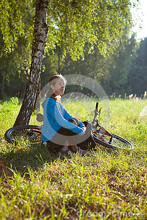 Cyclist enjoying relaxation in spring in the park