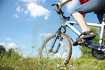 Cyclist on green grass