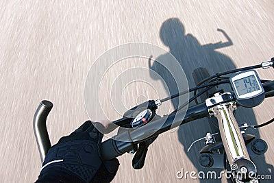 Cyclist Hand Glove on Speeding Bicycle Handlebar