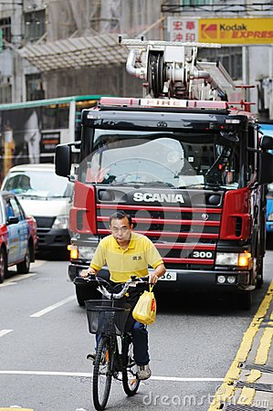 Cyclist in Hong Kong. Editorial Image