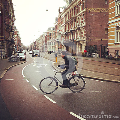 Free Cyclist In Amsterdam Stock Photography - 27568572