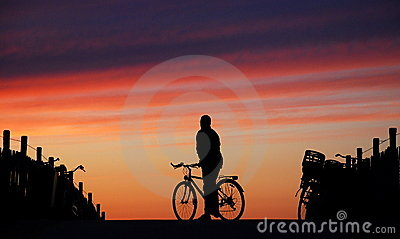 Cyclist Looking Into The Sunset