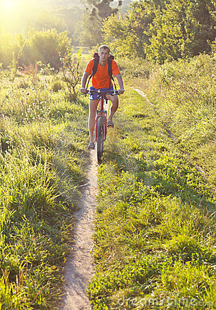 Cyclist on the Riding Bicycle Walk