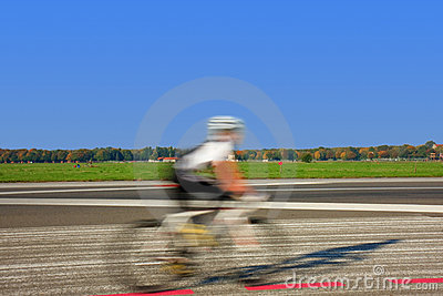 Cyclist riding a bike on the Tempelhof runaway