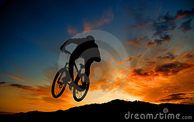 Cyclist silhouetted at sunset