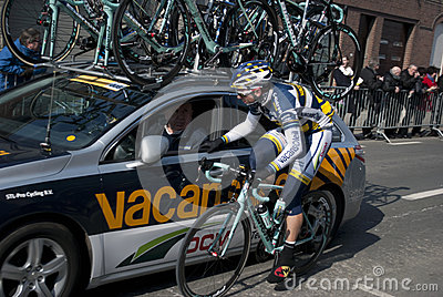 Cyclist at the team car Editorial Photography