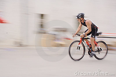 Cyclist in a village Editorial Stock Image