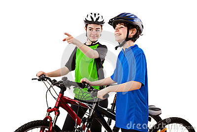 Cyclists - boy and girl isolated on white