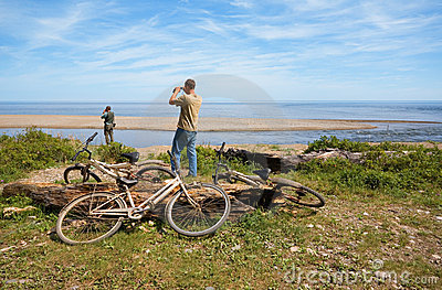 Cyclists on a deserted coast