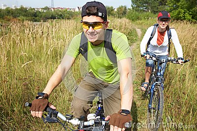 Cyclists on meadow
