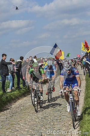 Cyclists Riding Paris-Roubaix 2014 Editorial Stock Image
