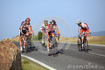 Cyclists riding uphill in Cindrel Mountains, Carpathians Mountains Editorial Image