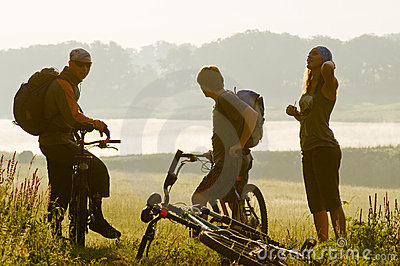 Cyclists at sunset