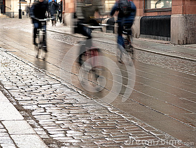 Cyclists on wet street