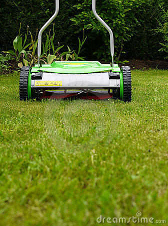 Cylinder lawn mower on grass
