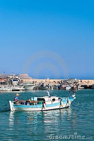 Cypriot fisherman in motor dory in Cyprus Editorial Image