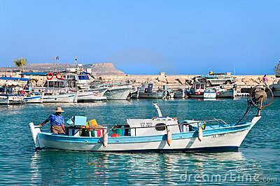 Cypriot fisherman in motor dory in Cyprus Editorial Photo