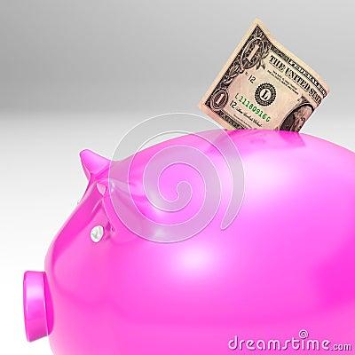 Dólar que entra em Piggybank que mostra economias