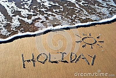 Día de fiesta escrito en arena