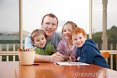 Dad coloring kids pictures with children Stock Photo