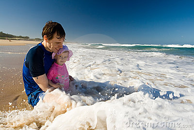 Dad and daugher on the beach