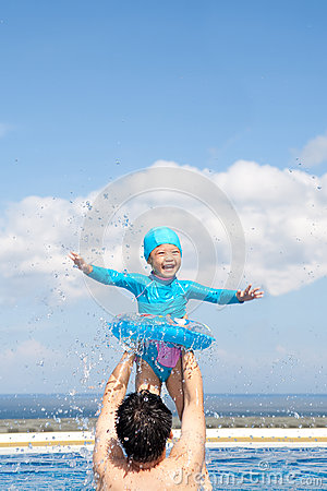 Dad and Daughter playing in swimming Pool