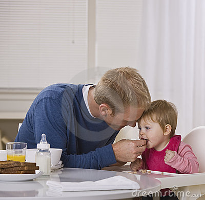 Dad Feeding Daughter Breakfast