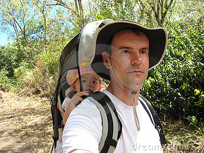 Dad hiking with baby daugther