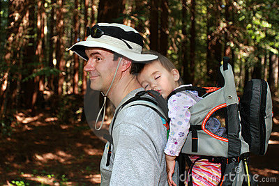 Dad hiking with baby girl