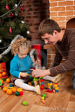 Dad and his daughter near Christmas tree