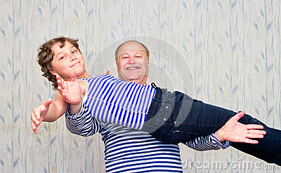 Dad holding his son on his outstretched hands