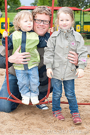 Dad with kids on playground