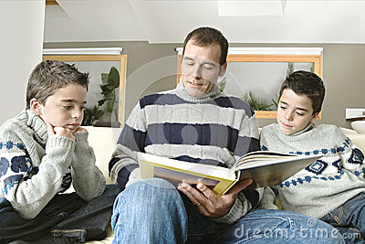 Dad and kids reading book