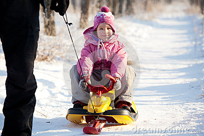Dad lucky child on a sled