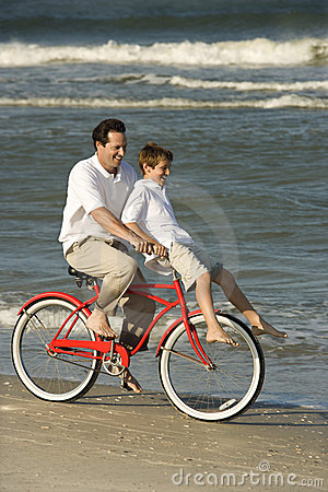 Dad riding bike with son
