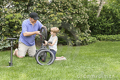 Dad and Son fixing a bike